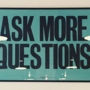 The words ask more questions as a framed picture on a wall